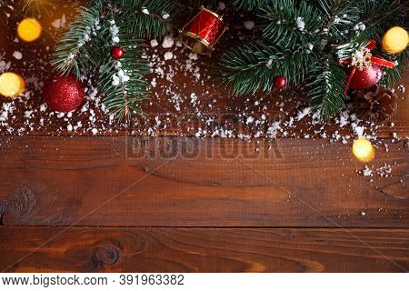 Green Branches Of A Christmas Tree With And Decoration On Wooden Background. Copy Space, Flat Lay, T