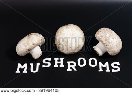 Three Champignons Are Arranged Horizontally. Below Is Written Mushrooms.