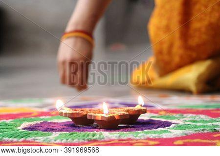 Happy Diwali - Diya Lamps Lit During Diwali Celebration. Colorful Diya Lamps Lit During Diwali Celeb
