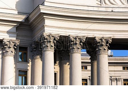 Colonnade With Corinthian Columns. Detailed View Of The Top Part Of Column Called Small Capital. Pil