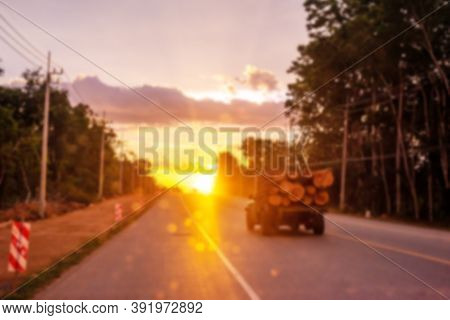 Blurred Old Car On Road With Colorful Of Sunset Or Sunrise In Twilight