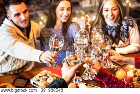 People Group Celebrating Christmas Toasting Champagne Wine At Home Dinner Party - Winter Holiday Con