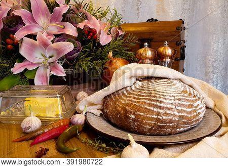 Fresh Homemade Artisan Bread. Round Bread On A Dark Background. Bread From Home Sourdough. Homemade