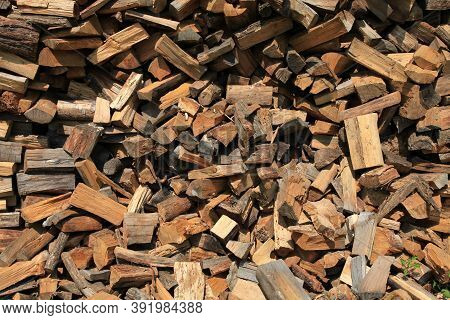 Firewood. Alternative And Cheap Energy Source For Heating. Heating Season. Background And Texture Of