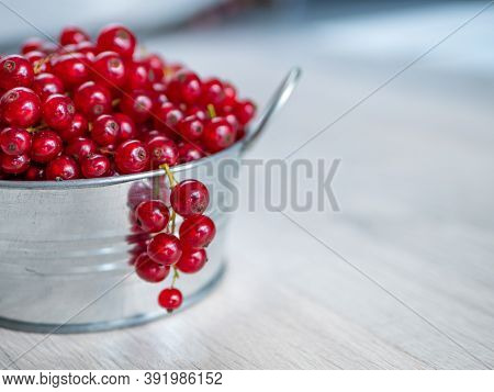A Metal Basin Filled With Red Currants