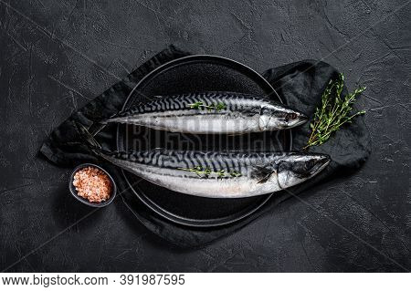 Raw Mackerel Fish With Thyme And Pink Salt. Fresh Seafood. Black Background. Top View. Space For Tex