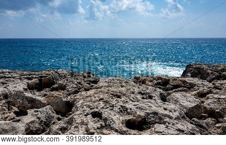Waves Crash On The Rocky Shore Of The Mediterranean Sea On The Akamas Peninsula In The Northwest Of