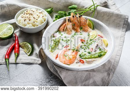 Homemade Tom Kha Gai. Coconut Milk Soup In A Bowl. Thai Food. Gray Background. Top View