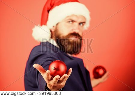 Giving Is Better Than Receiving. Man With Beard Hold Red Balls Christmas Decorations Selective Focus