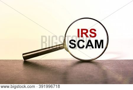Irs Scam, Text On Magnificent Glass On A Light Background