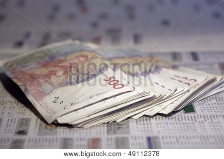 Money, banknotes on a newspaper.