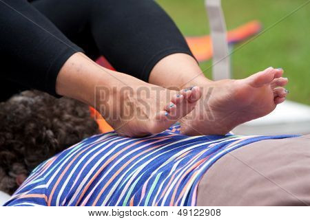 Woman Receives Ashiatsu Barefoot Massage At Summer Festival