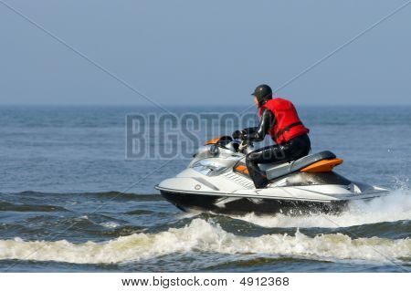 Jet Ski In Action With Water Spray On The Blue Sea