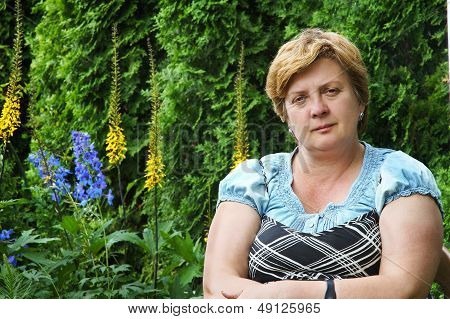 Middle-aged Woman In A Park