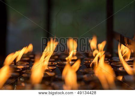 Burning Candles In Kathmandu Buddhist Temple