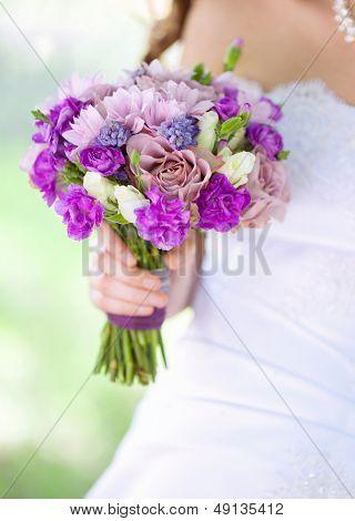 image of wedding bouquet in bride's hand