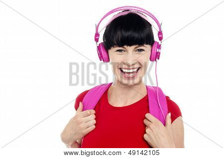 Young Girl Listening To Music, Using Headphones