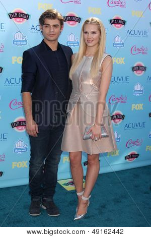 LOS ANGELES - AUG 11:  Garrett Clayton, Claudia Lee at the 2013 Teen Choice Awards at the Gibson Ampitheater Universal on August 11, 2013 in Los Angeles, CA