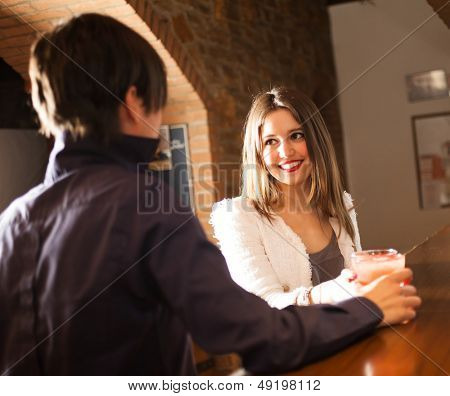 Couple having a drink in a pub