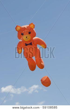 Orange Bear Kite Flys High