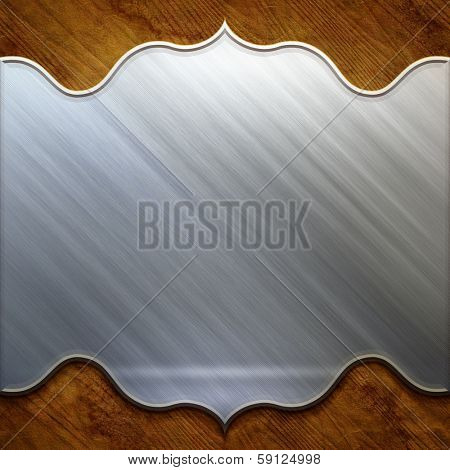 Metal signboard on old wooden background