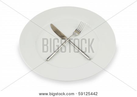silver knife and fork crossed on a white plate on white - gray background with light shaddow poster