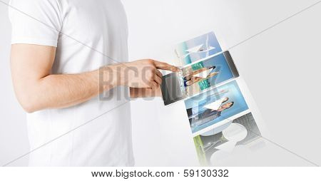 entertainment, future technology and video concept - closeup of man with tablet pc watching video