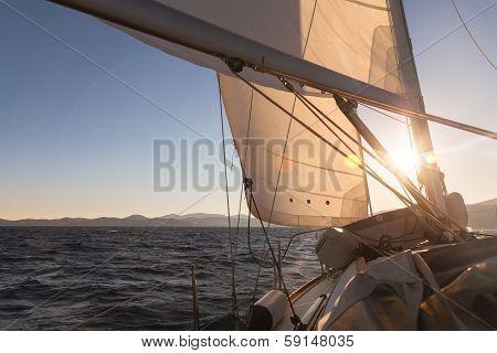 Sailboat At Sunset Ocean