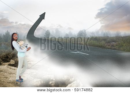 poster of Side view of young woman carrying a pile of books against road turning into arrow