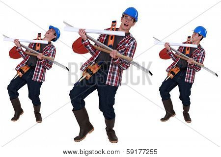 Handyman struggling to carry tools