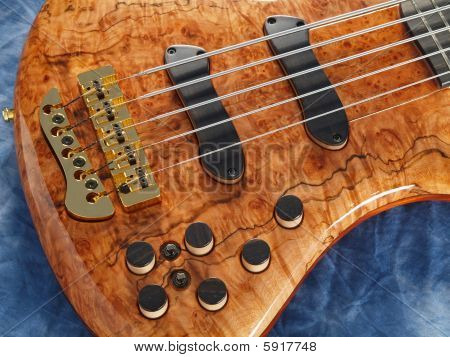 Curved Patterned Wood Bass Guitar Closeup