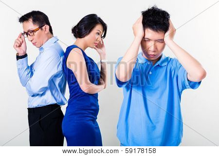 Young Chinese boy suffering from fighting parents and their divorce, the argument is affecting the whole family