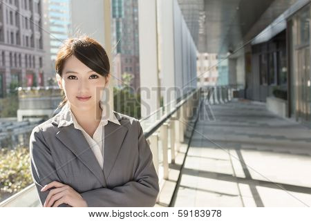 Portrait of attractive Asian business woman at modern building in Taipei, Taiwan, Asia.
