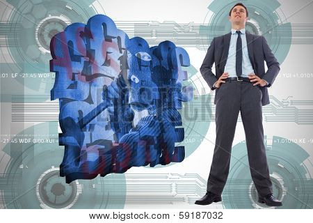 Happy businessman with hands on hips against technology wheel background