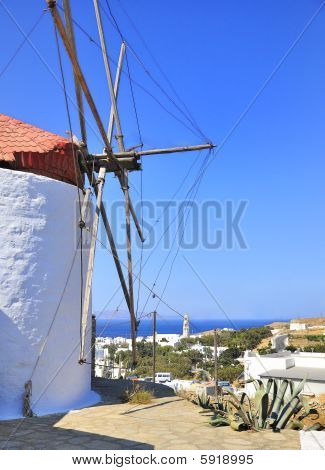 old windmill, towering above the sea, the countryside and the sky