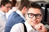 Smart highschool student with glasses posing poster