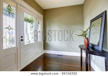 Entrance Hallway With Small Table And Mirror
