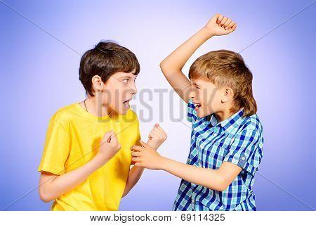 Two boys quarreled. Studio shot.