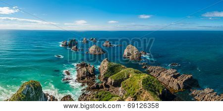 Nugget Point is located in the Catlins area on the Southern Coast of New Zealand, Otago region. The area is famous for many rock islands - nuggets - in the sea. Panoramic photo