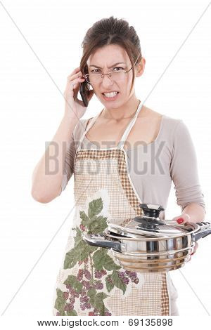 Angry Woman In The Kichen Holding Pot Altercating Over Phone