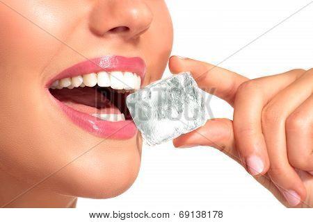 Closeup Of Beautiful Woman Biting An Ice Cube