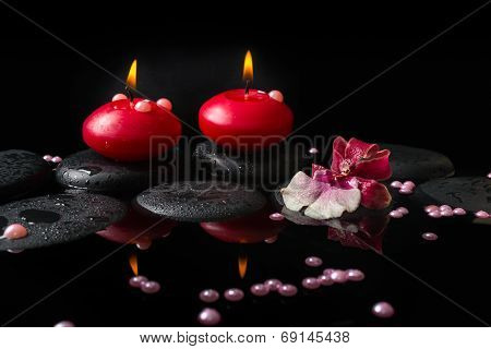 Beautiful Spa Concept Of White And Red Orchid (cambria), Red Candles And Pearl Beads On Zen Stones W