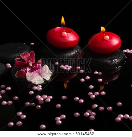 Spa Concept Of Red Candles, Zen Stones With Drops, Orchid Cambria Flower And Pearl Beads On Reflecti