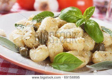 Gnocchi di patata, italian potato noodle with basil and pesto sauce poster