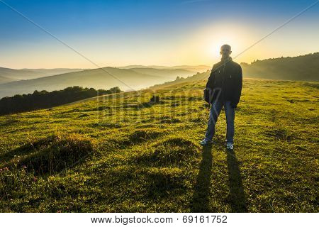 Man In Mountains Early In The Morning