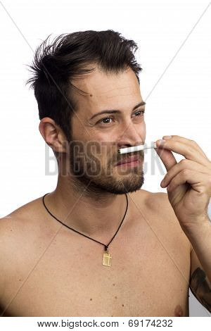 Man Smelling A Cigarette
