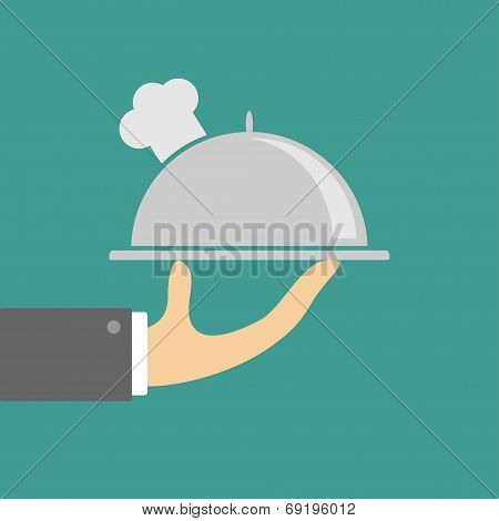 Hand Holding Silver Platter Cloche With Chefs Hat. Flat Design.
