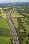 Helicopter aerial shot of traffic congestion on the M25 motorway around London England poster