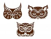 Wise old owl heads with decorative feather detail for tattoo or mascot design poster