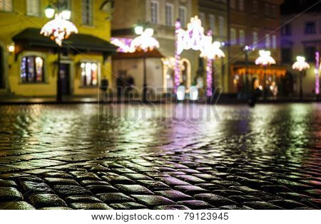 Wet Pavement And Festively Bedecked In Warsaw Old Town At Night